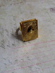 Golden book locket ring - $4,61