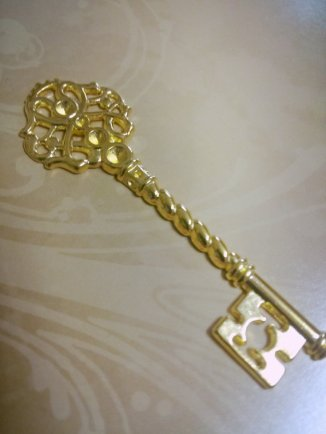 Golden antique key pendant - $2,06